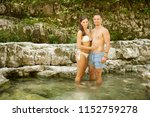 active couple rests on river... | Shutterstock . vector #1152759278
