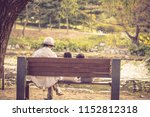 the back of the mother and the... | Shutterstock . vector #1152812318