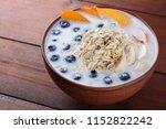 oatmeal porridge with milk and... | Shutterstock . vector #1152822242