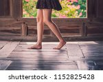 young woman is walking on floor ... | Shutterstock . vector #1152825428