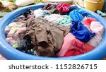 pile of clothes in the basin... | Shutterstock . vector #1152826715