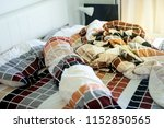 unmade bed with crumpled bed... | Shutterstock . vector #1152850565