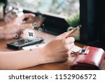 close up of young woman holding ...   Shutterstock . vector #1152906572