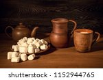 white marshmallow  a clay jug ... | Shutterstock . vector #1152944765