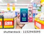 men hand holding modern mobile... | Shutterstock . vector #1152945095