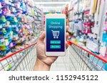 men hand holding modern mobile... | Shutterstock . vector #1152945122