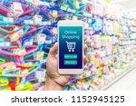 men hand holding modern mobile... | Shutterstock . vector #1152945125