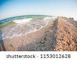 sea coast at sunset. the shore... | Shutterstock . vector #1153012628