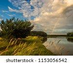 rainbow over he bug river.... | Shutterstock . vector #1153056542