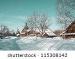 wooden chapel in winter village | Shutterstock . vector #115308142