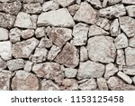traditional outside stony wall... | Shutterstock . vector #1153125458