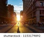 woman walks across an... | Shutterstock . vector #1153179892