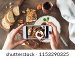 woman taking a photo of...   Shutterstock . vector #1153290325