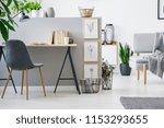 modern chair with wooden legs... | Shutterstock . vector #1153293655