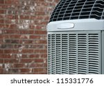 Close up shot of  High efficiency modern AC-heater unit on brick wall background - stock photo