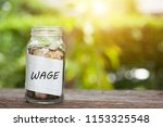 money in the glass and wage...   Shutterstock . vector #1153325548