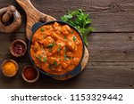 tasty butter chicken curry dish ... | Shutterstock . vector #1153329442