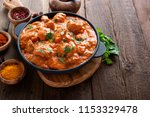 tasty butter chicken curry dish ... | Shutterstock . vector #1153329478