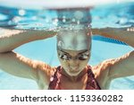 underwater shot of woman inside ... | Shutterstock . vector #1153360282