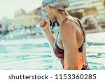 young female swimmer... | Shutterstock . vector #1153360285