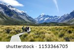some hikers visiting the... | Shutterstock . vector #1153366705