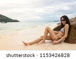 young slim asian woman wearing... | Shutterstock . vector #1153426828