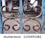 the gate is rusty. | Shutterstock . vector #1153491382