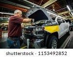 ron williams attaches a grill... | Shutterstock . vector #1153492852