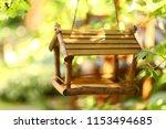 bird wooden creative feeder as... | Shutterstock . vector #1153494685