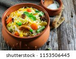 homemade vegetable biryani  ...   Shutterstock . vector #1153506445