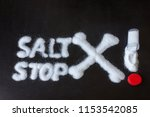 salt scattered on black surface.... | Shutterstock . vector #1153542085
