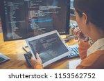 programmer working in a... | Shutterstock . vector #1153562752