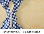 wood spoon with blue cell...   Shutterstock . vector #1153569865