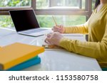female students wear yellow... | Shutterstock . vector #1153580758