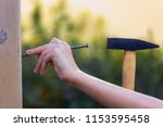 a hammer and a nail  one child...   Shutterstock . vector #1153595458