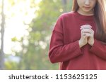 woman praying in the morning on ... | Shutterstock . vector #1153625125