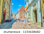 Small photo of KRAKOW, POLAND - JUNE 21, 2018: Narrow winding streets with scenic medieval edifices are the perfect place to walk anf enjoy atmosphere of old town, on June 21 in Krakow.