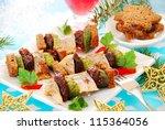 herring skewers with prune,dark bread gherkin  for christmas - stock photo
