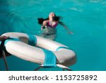 man holding out life preserver... | Shutterstock . vector #1153725892