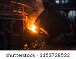 pouring of liquid metal in open ... | Shutterstock . vector #1153728532