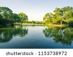 lake lawn woods reflection | Shutterstock . vector #1153738972