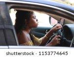 side view of pretty black woman ... | Shutterstock . vector #1153774645
