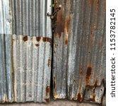 the door is made of rusty roof. | Shutterstock . vector #1153782145
