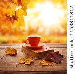 autumn leaves  book and cup of... | Shutterstock . vector #1153811812