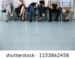 row of candidates sitting on... | Shutterstock . vector #1153862458