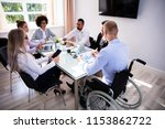 disabled male manager sitting... | Shutterstock . vector #1153862722