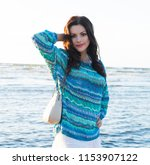 the woman in a sweater of... | Shutterstock . vector #1153907122