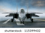 An f 14 jet fighter on an...
