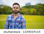 portrait of young handsome... | Shutterstock . vector #1154019115