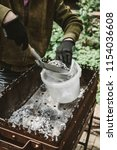 cleaning the brazier after a... | Shutterstock . vector #1154036608